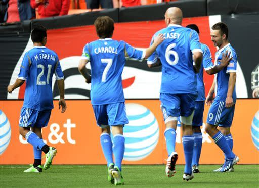 Philadelphia Union forward Jack McInerney (9) celebrates his goal with Michael Farfan (21), Brian Carroll (7) and Conor Casey (6) and others during the first half of an MLS soccer match against D.C. United, Sunday, April 21, 2013, in Washington. (AP Photo/Nick Wass)