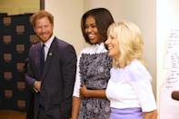 <p>To support of the Invictus Games Orlando 2016, Prince Harry was joined by the first and second ladies to tour art and music therapy programs that help injured service members. Michellee Obama wore a black and white collared dress with an abstract floral print, while Jill Biden looked delightful in a lilac pencil skirt and white three-quarter sleeved shirt. The British royal looked delightfully dapper in a navy blue suit and tie, wearing woven bracelets from Africa and a pin in support of his favorite charity. Based on the laughs, it seems his red scruff and English charm made the ladies swoon. No one's immune. <br></p>