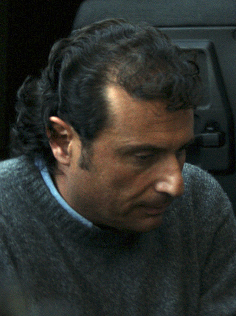 FILE - In this file photo of Tuesday, Jan. 17, 2012 Francesco Schettino, the captain of the Costa Concordia cruise ship that run aground the tiny Island of Giglio last Friday, leaves the Grosseto court, Italy. Seamen have expressed almost universal outrage at Capt. Francesco Schettino, accused of manslaughter, causing a shipwreck and of abandoning his crippled cruise ship off Tuscany while passengers were still on board. The charge of abandoning his ship carries a potential sentence of 12 years in prison. Seafaring tradition holds that the captain should be last to leave a sinking ship. But is it realistic to expect skippers _ only human after all _ to suppress their survival instinct amid the horror of a maritime disaster? To ask them to stare down death from the bridge, as the lights go out and the water rises, until everyone else has made it to safety? From mariners on ships plying the world's oceans, the answer is loud and clear: Aye. (AP Photo/Alessandro La Rocca, Lapresse, file)   ITALY OUT
