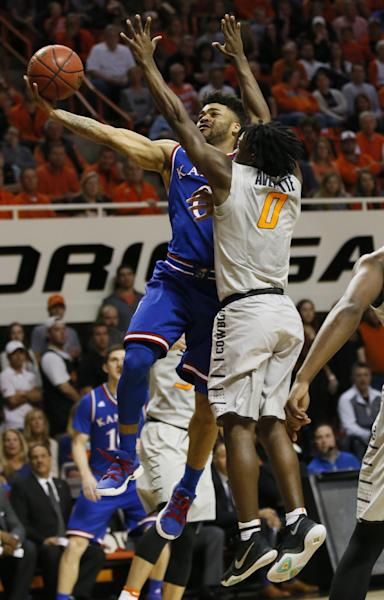 Kansas guard Frank Mason III (0) shoots in front of Oklahoma State guard Brandon Averette (0) in the second half of an NCAA college basketball game in Stillwater, Okla., Saturday, March 4, 2017. Kansas won 90-85. (AP Photo/Sue Ogrocki)