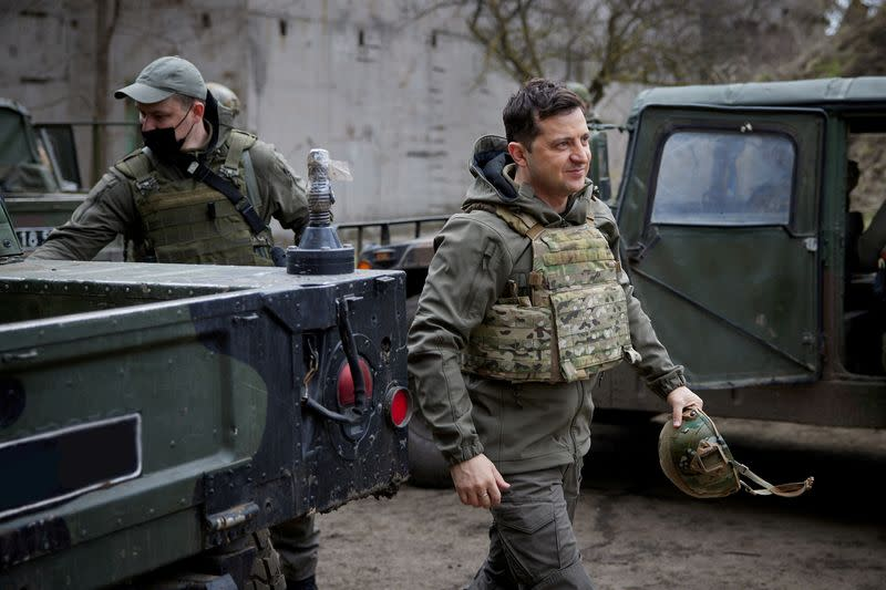 FILE PHOTO: Ukraine's President Volodymyr Zelenskiy visits positions of armed forces in Donbass region