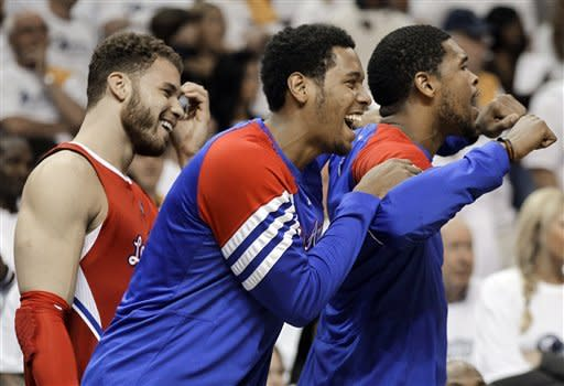 Los Angeles Clippers forward Trey Thompkins, center, celebrates with teammates Blake Griffin, left, and DeAndre Jordan, right, in the final seconds of Game 7 against the Memphis Grizzlies in a first-round NBA basketball playoff series on Sunday, May 13, 2012, in Memphis, Tenn. The Clippers won 82-72 to take the series 4-3. (AP Photo/Mark Humphrey)