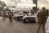 """<p>The Revival could sell tickets to the trackside pen alone, where the entrants in a race gather before lining up on the grid. The <a href=""""https://www.goodwood.com/grr/event-coverage/goodwood-revival/2021/9/video-revival-2021-freddie-march-memorial-trophy/"""" rel=""""nofollow noopener"""" target=""""_blank"""" data-ylk=""""slk:Freddie March Memorial Trophy"""" class=""""link rapid-noclick-resp"""">Freddie March Memorial Trophy</a> featured runners like a 1952 Jaguar C-Type—one year younger than the <a href=""""https://www.caranddriver.com/news/a37456081/jaguar-c-type-continuation-revealed/"""" rel=""""nofollow noopener"""" target=""""_blank"""" data-ylk=""""slk:three C-type continuation cars"""" class=""""link rapid-noclick-resp"""">three C-type continuation cars</a> Jaguar is making, a 1956 Jaguar D-type, a 1950 Maserati 300S, a 1953 Ferrari 250MM, a 1952 Aston Martin DBS, and that boot-stamped 300SL. Standing in the middle of them all coming to life at once is like opera—one sung by a band of dyspeptic pets from Satan's kennel that reek of oil and will not quit until your eardrums boil.</p>"""