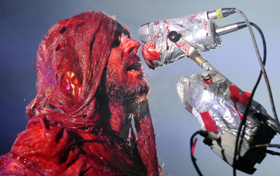 "Covered in pig's blood in an homage to the horror film ""Carrie,"" Wayne Coyne, of The Flaming Lips, performs during their ""Halloween Blood Bath"" tour stop at The Greek Theatre on Tuesday, Oct. 29, 2013, in Los Angeles. (Photo by Chris Pizzello/Invision/AP)"