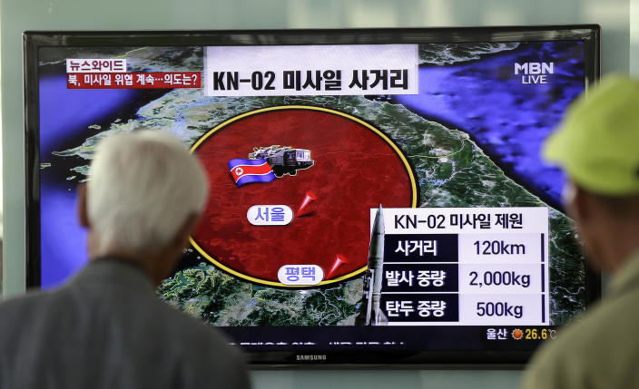 South Korean men watch a TV news program reporting missile launch conducted by North Korea, at a Seoul train station in Seoul, South Korea, Monday, May 20, 2013. North Korea fired two more short-range projectiles into its own eastern waters Monday for a third straight day of such launches, Seoul officials said, as Pyongyang threatened to retaliate against what it calls South Korean and U.S. criticism of its sovereign rockets tests. (AP Photo/Lee Jin-man)