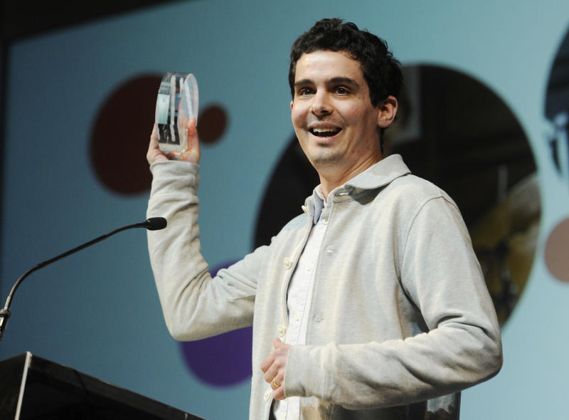 """Damien Chazelle, director of """"Whiplash,"""" accepts the Grand Jury Prize: Dramatic award for his film during the 2014 Sundance Film Festival Awards Ceremony on Saturday, Jan. 25, 2014, in Park City, Utah. (Photo by Chris Pizzello/Invision/AP)"""