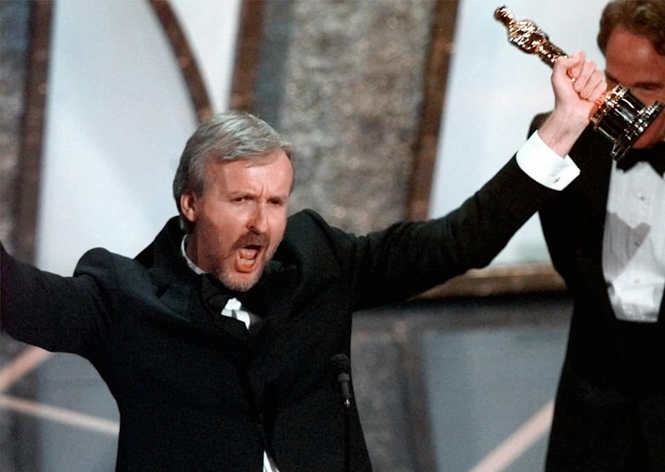 James Cameron accepting the Best Director Oscar for Titanic at the 70th Academy Awards in Los Angeles Monday, March 23, 1998. Titanic also won for Best Picture. (AP Photo/Susan Sterner)