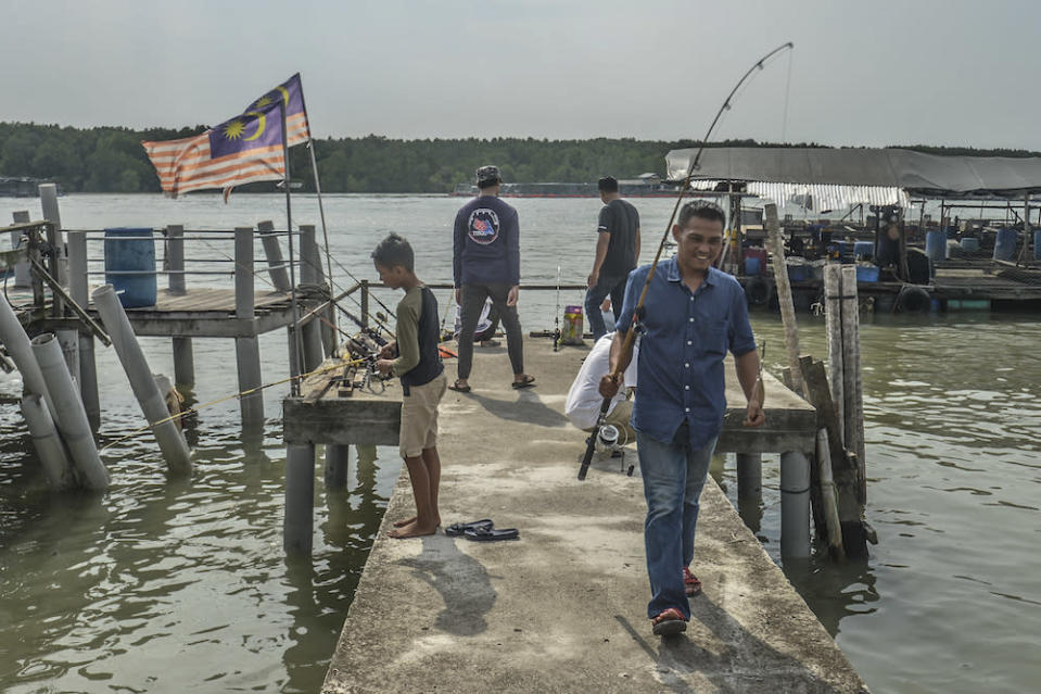People fish in Kampung Air Masin in Kukup November 3, 2019. — Picture by Shafwan Zaidon