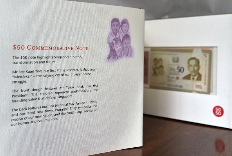 """A misspelling of Singapore's first president """"Yusok Ishak"""" in the third paragraph can be seen on a folder kit of the 50 Singapore dollar commemorative note (AFP Photo/Roslan Rahman)"""