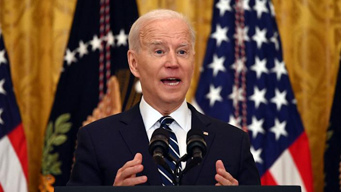 US President Joe Biden answers a question during his first press briefing in the East Room of the White House in Washington, DC, on March 25, 2021. (Jim Watson/AFP via Getty Images)