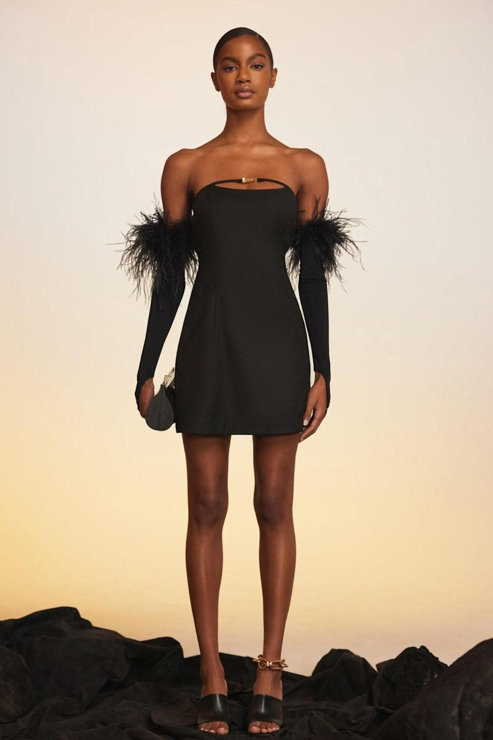"""Feather sleeves have entered the chat. We'll see ourselves out now. $428, Cult Gaia. <a href=""""https://cultgaia.com/products/jaslene-dress-black"""" rel=""""nofollow noopener"""" target=""""_blank"""" data-ylk=""""slk:Get it now!"""" class=""""link rapid-noclick-resp"""">Get it now!</a>"""