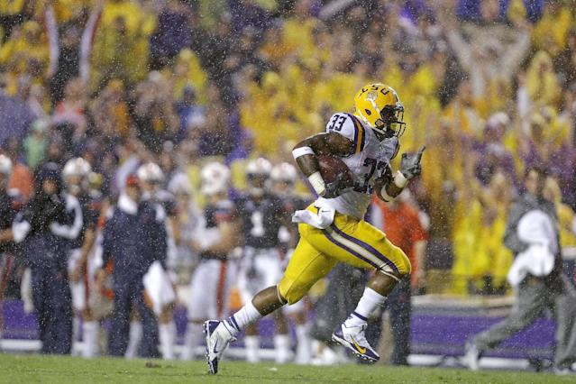 LSU running back Jeremy Hill (33) carries on his first touchdown in the first half of an NCAA college football game against Auburn in Baton Rouge, La., Saturday, Sept. 21, 2013. (AP Photo/Gerald Herbert)