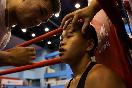 Huang Wensi sits in her corner during her fight against Thailand's Jarusiri Rongmuang for the Asia Female Continental Super Flyweight Championship gold belt in Taipei, Taiwan, September 26, 2018. REUTERS/Yue Wu