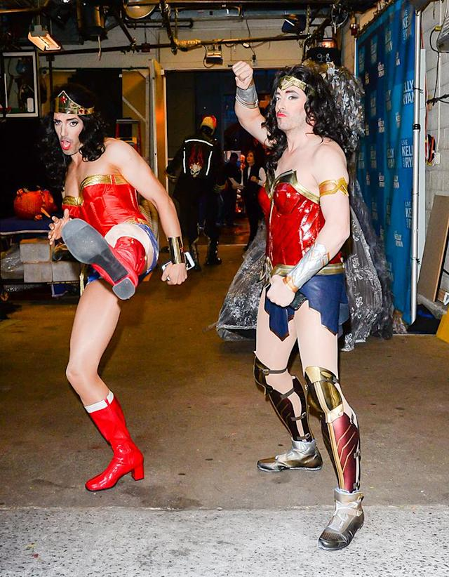 <p>Stay off their property! The HGTV stars looked twice as fierce in their twin Wonder Woman costumes outside the <em>Live With Kelly and Ryan</em> studio on Halloween. (Photo: Raymond Hall/GC Images) </p>