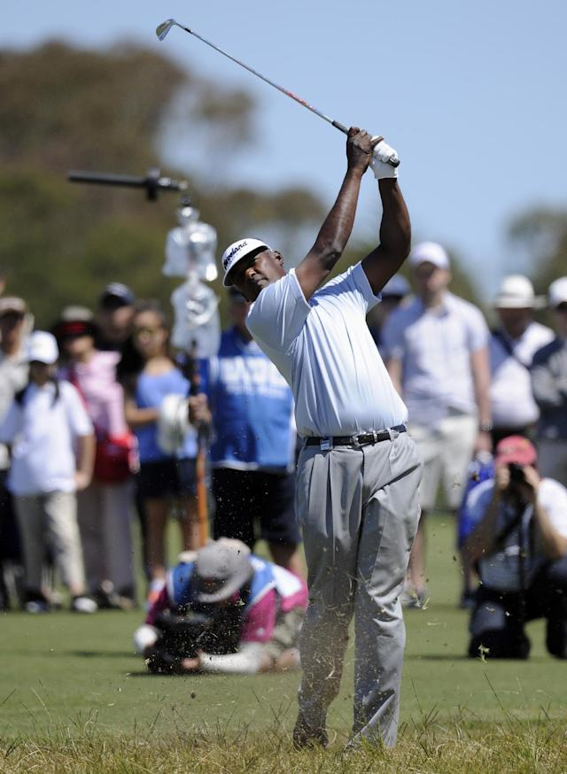 Vijay Singh from Fiji hits an approach shot during the final round of the Australian Masters golf tournament at Royal Melbourne Golf Course in Melbourne, Australia, Sunday, Nov. 17, 2013. (AP Photo/Andy Brownbill)