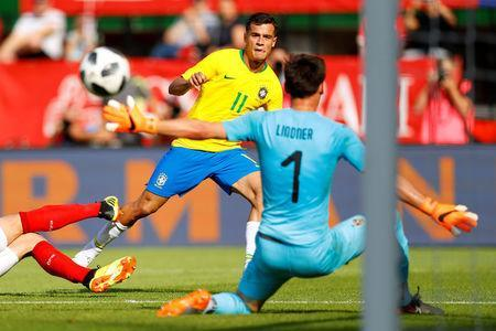Soccer Football - International Friendly - Austria vs Brazil - Ernst-Happel-Stadion, Vienna, Austria - June 10, 2018 Brazil's Philippe Coutinho scores their third goal REUTERS/Leonhard Foeger