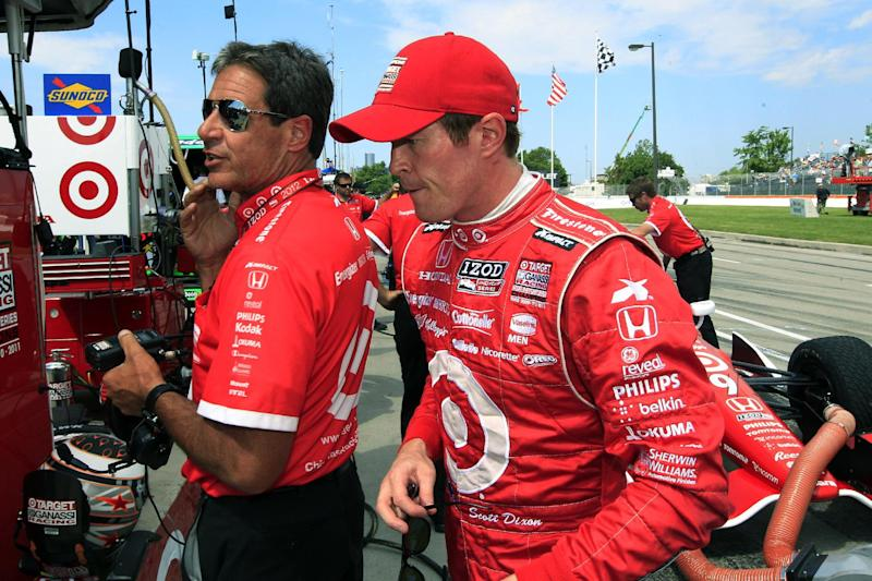 Scott Dixon walks in the pit after his practice laps for IndyCar's Detroit Grand Prix auto race on Belle Isle in Detroit, Sunday, June 3, 2012. (AP Photo/Carlos Osorio)