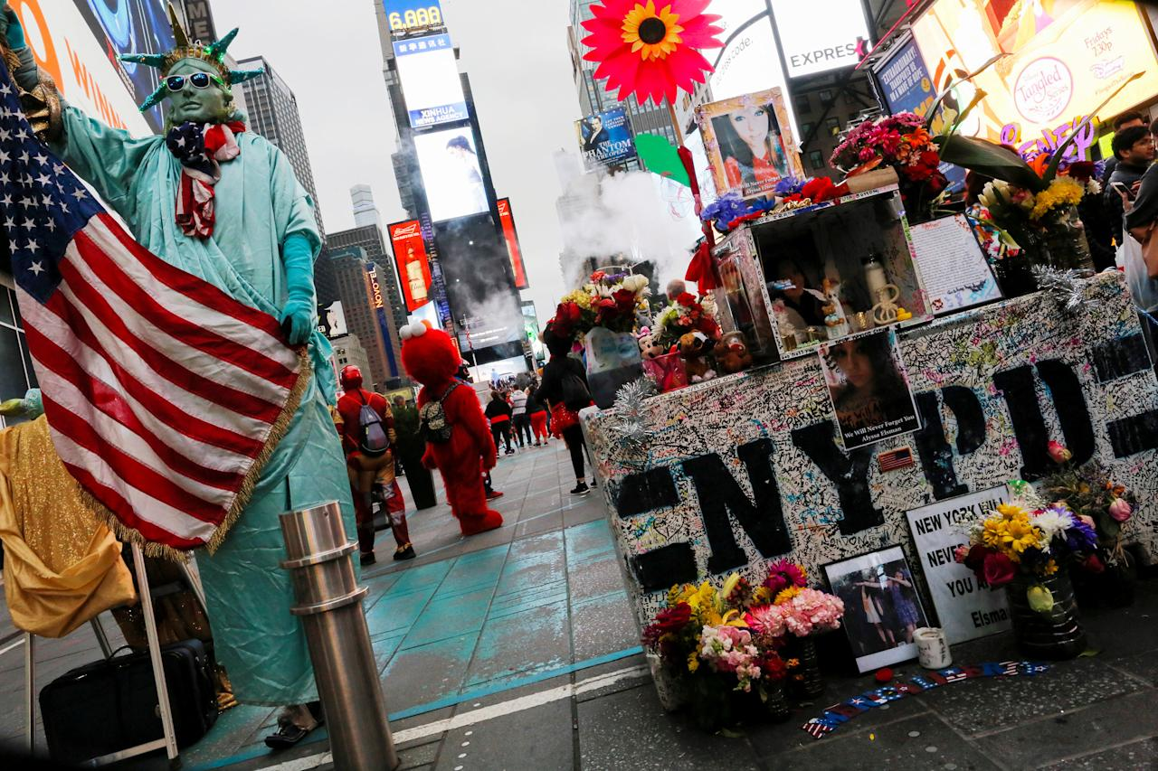 Names are written on a memorial that has been created in Times Square for Alyssa Elsman in New York City, New York, U.S., May 29, 2017. REUTERS/Eduardo Munoz