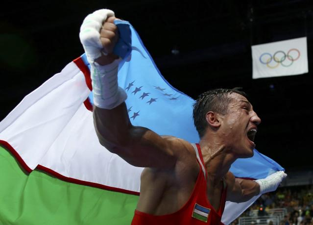 2016 Rio Olympics - Boxing - Final - Men's Light Welter (64kg) Final Bout 272 - Riocentro - Pavilion 6 - Rio de Janeiro, Brazil - 21/08/2016. Fazliddin Gaibnazarov (UZB) of Uzbekistan celebrates after winning his bout. REUTERS/Peter Cziborra TPX IMAGES OF THE DAY. FOR EDITORIAL USE ONLY. NOT FOR SALE FOR MARKETING OR ADVERTISING CAMPAIGNS.