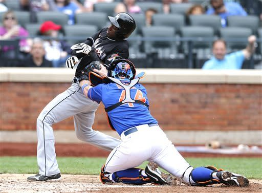 Miami Marlins' Adeiny Hechavarria (3) is tagged out at home trying to score on a single by Marlins' Juan Pierre as New York Mets catcher John Buck (44) places the tag during the fifth inning of a baseball game at Citi Field in New York, Saturday, June 8, 2013. (AP Photo/Paul J. Bereswill)