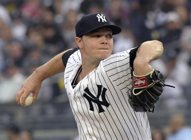 New York Yankees starting pitcher Sonny Gray winds up during the first inning of the team's baseball game against the Washington Nationals on Wednesday, June 13, 2018, at Yankee Stadium in New York. (AP Photo/Bill Kostroun)