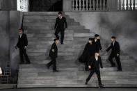 Actors perform wearing masks during 'Cavalleria Rusticana' lyric opera, at the Arena di Verona theatre, in Verona, Italy, Friday, June 25, 2021. The Verona Arena amphitheater returns to staging full operas for the first time since the pandemic struck but with one big difference. Gone are the monumental sets that project the scene to even nosebleed seats in the Roman-era amphitheater, replaced by huge LED screens with dynamic, 3D sets that are bringing new technological experiences to the opera world. (AP Photo/Luca Bruno)