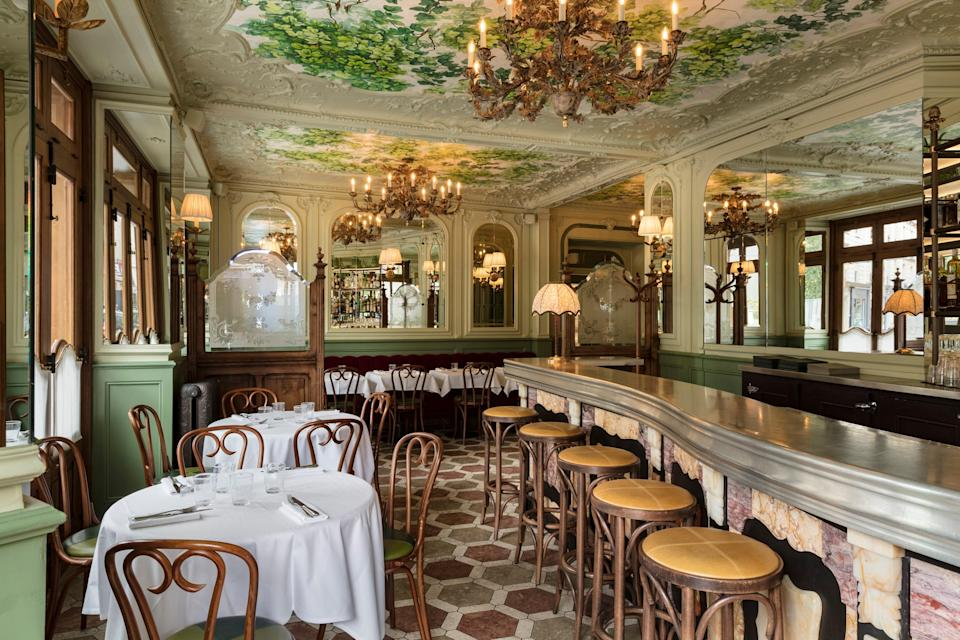 """<p><strong>What were your first impressions when you arrived?</strong> """"Wow,"""" will undoubtedly be your first thought, or even come out of your mouth, upon walking into this newly-restored Belle Epoque-era dining room just off trendy rue Paul Bert in the 11th arrondissement. Between the striking marble bar and antique stools, the mint green floral moldings, the detailed ceiling murals — it's exactly what you envision when you think """"old"""" Paris. That said, it's not stuffy at all; rather it feels fresh and light probably thanks to London-based designer Martin Brudnizki who updated the room in 2018.</p> <p><strong>What's the crowd like?</strong> For lunch, it's a business-friendly crowd of well-heeled locals who dress well (loafers sans socks, kitten heels, skirts with Vejas) and know they're also about to throw down for a memorable meal.</p> <p><strong>What should we be drinking?</strong> As part of the refresh, clever cocktails have been added to the evening menu such as the flirty """"Midnight in Paris"""" with hibiscus vodka or the refreshing """"Green Garden"""" with gin, cucumber, shiso and mint. The actual bar itself is so inviting that you could easily come for a cocktail and not even eat. That said, if you are staying, and prefer wine (or want to move to wine) there is an extensive list with varietals from France and beyond. The sommelier is also happy to point out options by the glass that pair nicely with whatever you order.</p> <p><strong>Main event: the food. Give us the lowdown—especially what not to miss.</strong> Prior to celebrity chef Cyril Lignac taking over the restaurant in 2014, it was predominantly seafood-focused. Lignac kept it fish-friendly over the years, but after this last update has clearly moved away from traditional bistro classics to focus on more """"approachable"""" (read: Millennial-loving) fare like poké or crispy sushi. That said, there's plenty of meat, too, and a hamburger to boot—a very good one at that. (The bun alone is worth the calories). The """
