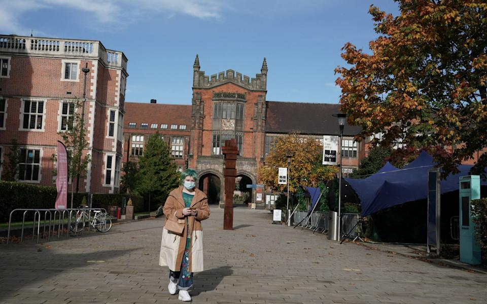 A student walks in front of the Arches at Newcastle University in Newcastle -  Owen Humphreys / PA