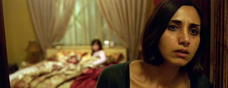 Narges Rashidi gets spooked in Under The Shadow (credit: XYZ Films)