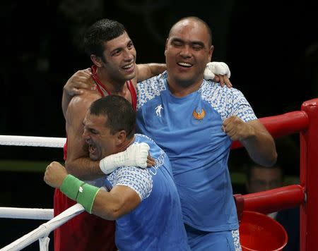 2016 Rio Olympics - Boxing - Final - Men's Fly (52kg) Final Bout 271 - Riocentro - Pavilion 6 - Rio de Janeiro, Brazil - 21/08/2016. Shakhobidin Zoirov (UZB) of Uzbekistan celebrates after winning his bout. REUTERS/Matthew Childs