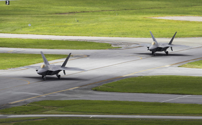In this Aug. 14, 2012 photo, two U.S. Air Force F-22 Raptors taxi before take off from Kadena Air Base on the southern island of Okinawa, in Japan. The deployment of a dozen F-22 stealth fighters to Japan has so far gone off without a hitch as the aircraft are being brought back into the skies in their first overseas mission since restrictions were imposed over incidents involving pilots getting dizzy and disoriented, a senior U.S. Air Force commander told the Associated Press on Thursday, Aug. 30, 2012. (AP Photo/Greg Baker)