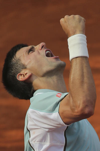 CORRECTS PHOTOGRAPHER'S NAME Serbia's Novak Djokovic celebrates defeating Germany's Tommy Haas in three sets 6-3, 7-6, 7-5, in their quarterfinal match at the French Open tennis tournament, at Roland Garros stadium in Paris, Wednesday June 5, 2013. (AP Photo/Michel Euler)