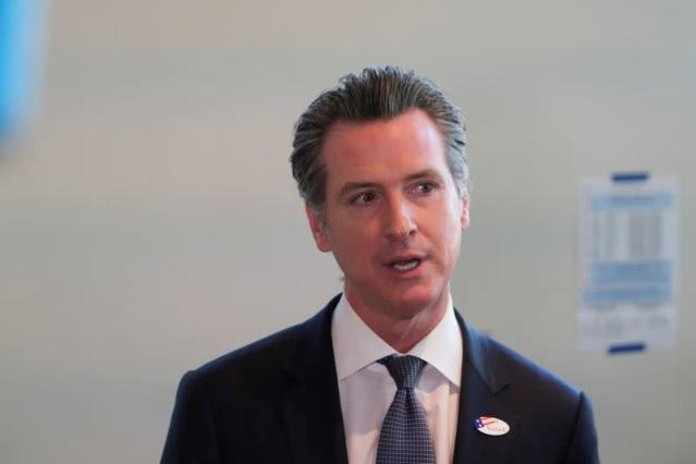 FILE PHOTO: California's Governor Gavin Newsom speaks to the media after casting his vote at a voting center at The California Museum for the presidential primaries on Super Tuesday in Sacramento