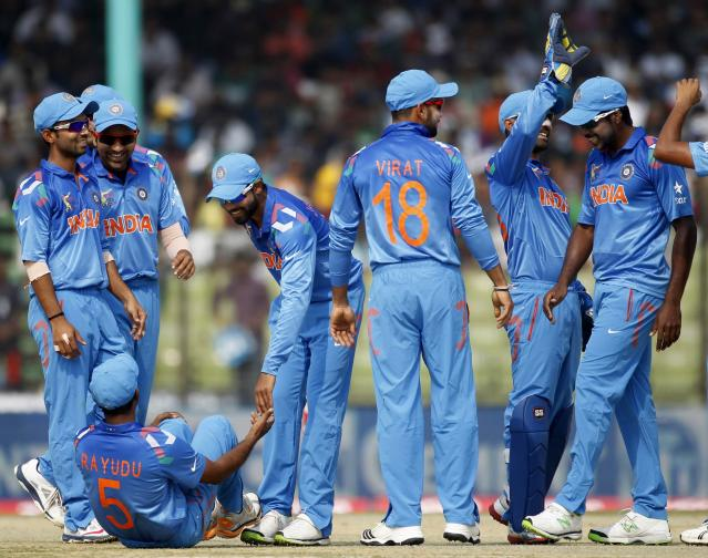 India's fielders celebrate the dismissal of Bangladesh's Shamsur Rahman (unseen) during their Asia Cup 2014 one-day international (ODI) cricket match in Fatullah February 26, 2014. REUTERS/Andrew Biraj (BANGLADESH - Tags: SPORT CRICKET)