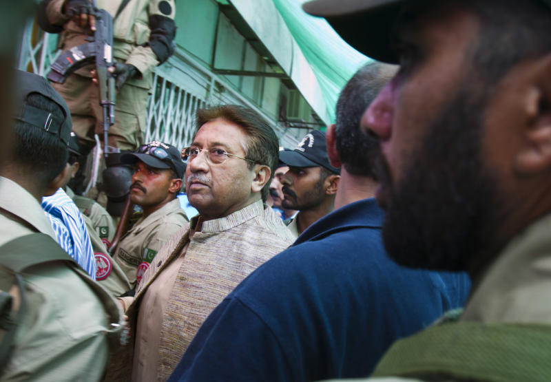 Pakistan's former President and military ruler Pervez Musharraf, center, arrives in an anti-terrorism court in Islamabad, Pakistan on Saturday, April 20, 2013. The general who ruled Pakistan for nearly a decade before being forced to step down appeared Saturday in front of an anti-terrorism court in connection with charges linked to his 2007 sacking and detention of a number of judges. (AP Photo/Anjum Naveed)