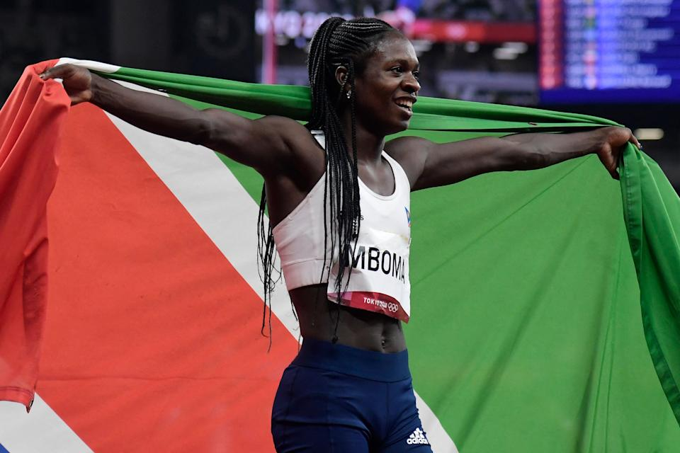 Namibia's Christine Mboma celebrates with the flag of Namibia after placing second of the women's 200m final during the Tokyo 2020 Olympic Games at the Olympic Stadium in Tokyo on August 3, 2021. (Photo by Javier SORIANO / AFP) (Photo by JAVIER SORIANO/AFP via Getty Images)