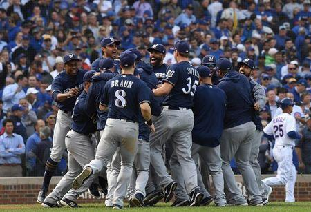 Oct 1, 2018; Chicago, IL, USA; The Milwaukee Brewers celebrate after defeating the Chicago Cubs in the National League Central division tiebreaker game at Wrigley Field. Mandatory Credit: Patrick Gorski-USA TODAY Sports