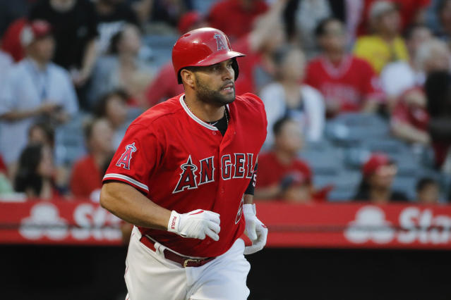 Albert Pujols is reportedly expected to miss the rest of the season after having surgery on his left knee. (AP)
