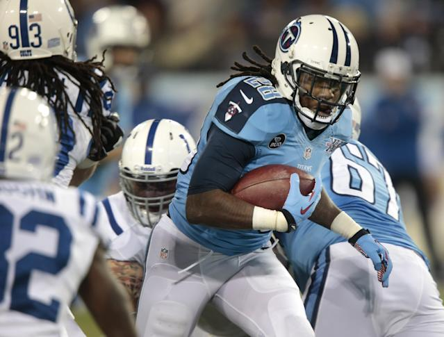 Tennessee Titans running back Chris Johnson (28) runs 30 yards for a touchdown against the Indianapolis Colts in the first quarter of an NFL football game Thursday, Nov. 14, 2013, in Nashville, Tenn. (AP Photo/Wade Payne)