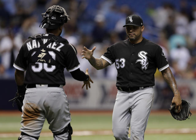 Chicago White Sox relief pitcher Hector Santiago (53) celebrates with catcher Omar Narvaez after the White Sox defeated the Tampa Bay Rays 3-2 in 10 innings in a baseball game Friday, Aug. 3, 2018, in St. Petersburg, Fla. (AP Photo/Chris O'Meara)