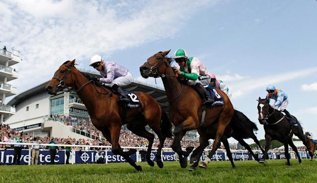 Merry Me ridden by Jim Crowley (C) is beaten by Gratzie with Silvestre De Sousa on board (L) in the The Investec Mile on Ladies Day at the Epsom Derby Festival in Surrey, southern England, on June 5, 2015 (AFP Photo/Adrian DENNIS)