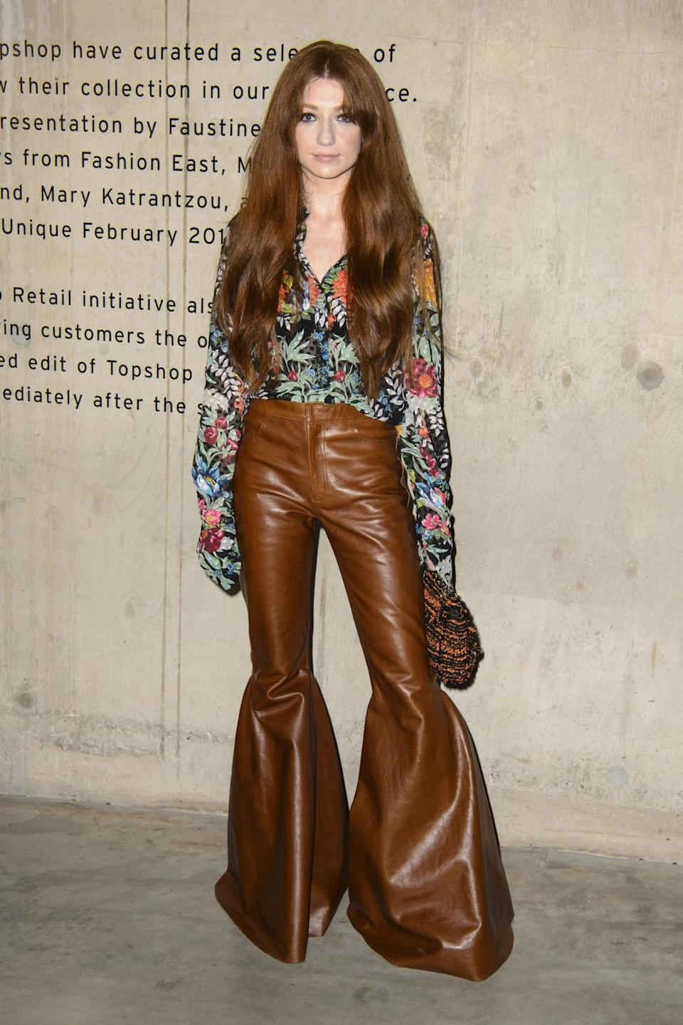 <p>Nicola Roberts stood out in leather flares and a floral shirt. <i>[Photo: PA]</i> </p>