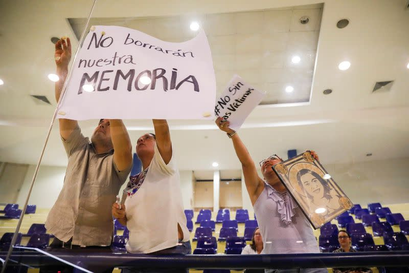 Human rights activist protests during a congress session against approving an amnesty bill that exempts the prosecution of crimes committed during the civil war, in San Salvador, El Salvador
