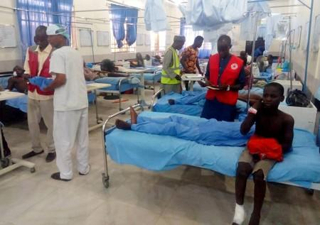 Injured people receive treatment inside a hospital in Maiduguri, after a triple suicide attack in northeast Nigerian state of Borno