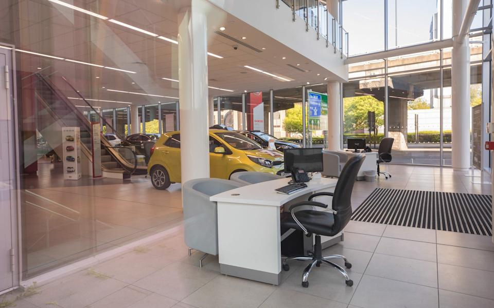car showroom - Jason Alden/Bloomberg