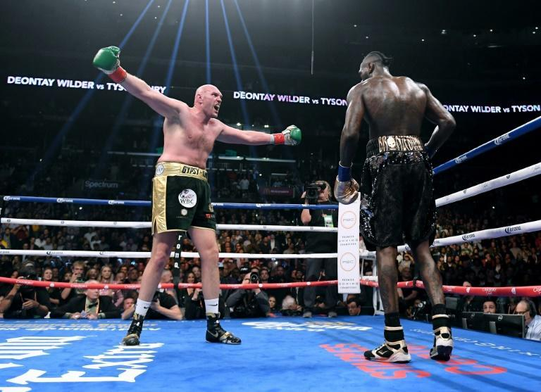 Tyson Fury taunts Deontay Wilder during the duo's first fight in Los Angeles in 2018 (AFP/Harry How)