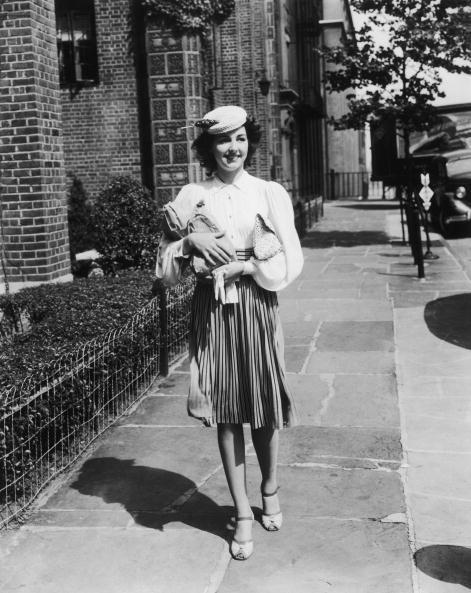 <p>The return of the pleated skirt, with ankle-strap heels to boot.</p>
