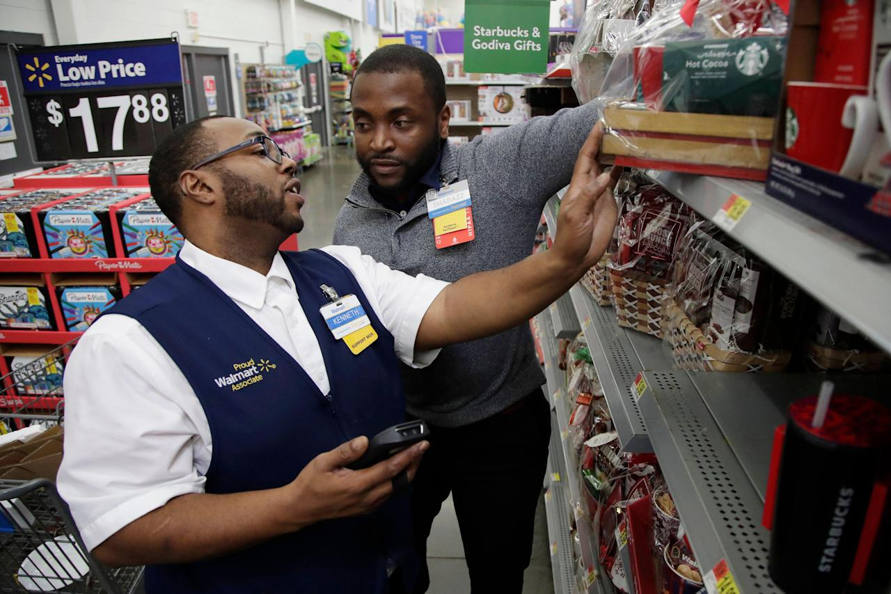 Walmart's hourly wages for employees 'will go beyond [$15