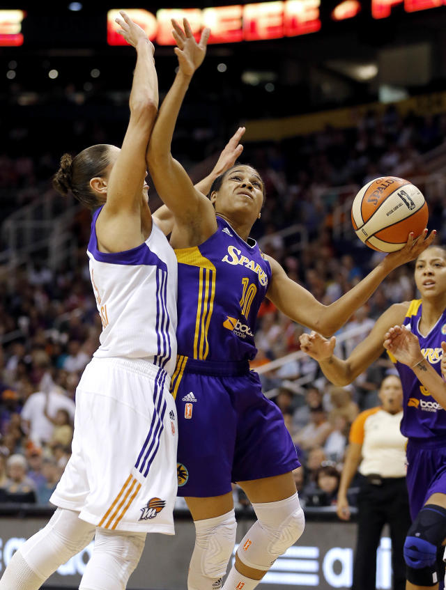 Los Angeles Sparks' Lindsey Harding (10) drives against Phoenix Mercury's Diana Taurasi during the first half of Game 2 of a WNBA basketball Western Conference semifinal series, Saturday, Sept. 21, 2013, in Phoenix. (AP Photo/Matt York)