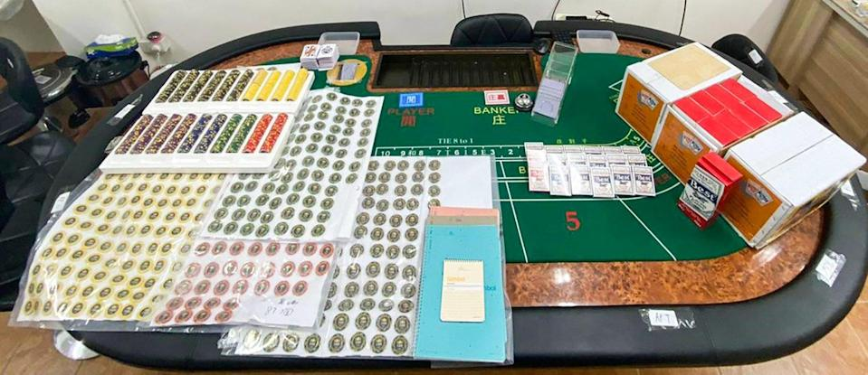 Cards and gambling chips seized in an illegal baccarat den in Sai Ying Pun on Tuesday. Photo: Handout